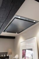 An extractor fan built into an illuminated ceiling