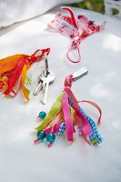 Homemade tassels made of colourful ribbons as a pendant for keys or memory sticks