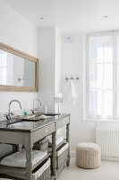 Grey washstand in bathroom