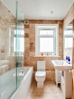 Stone tiles in bright bathroom