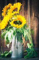 Vase of sunflowers; double exposure