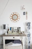 Retro lamp and vanity mirror on table with drawer next to card rack
