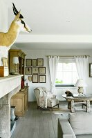 Hunting trophy and comfortable wing-back chair in rustic living area