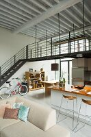 Living area in open-plan loft apartment with mezzanine