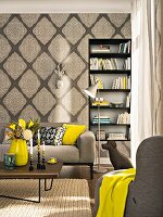 An elegant living room with ornamental non-woven wallpaper in shades of beige and mustard-coloured colour accents