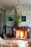 Open fire and flower arrangement in vintage interior