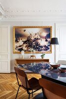 Dining area in restored period apartment with large artwork