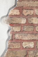 Wall with section of exposed brick and white render