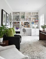 White shelving with integrated desk in living area