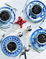 Red Eiffel tower ornament and blue and white china on set table