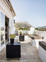 Summery terrace with Mediterranean ambiance and view of mountains