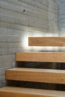Indirect lighting emphasising floating effect of wooden stair treads