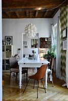 White wooden table and oak parquet floor in renovated, retro, period apartment