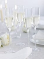 Champagne on table laid for special occasion
