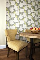 Table and Chair; Bowl of Peaches; Wallpapered Wall