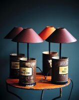 Small table lamps in old medicine cans