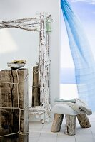 An artistically made mirror, stool and side table made from driftwood