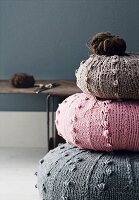 Round cushions with knitted covers