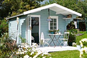 Light blue, wooden, Scandinavian-style summer house
