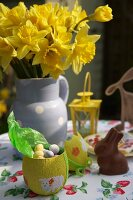 Easter sweets and daffodils on garden table