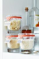 Kitchen supplies in jars sealed with cling film and preserving jar rubber bands