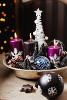Bowl with candles and Christmas decorations
