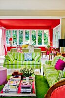 Living-dining area in shades of red and green