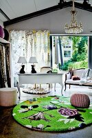 Green rug with modern pattern in front of white antique furniture
