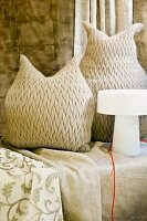 Owl-shaped, woven cushions