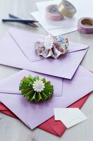 Colourful paper flowers decorating colourful envelopes