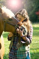 Girl and horse outdoors