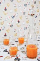 Pattern of hens on tablecloth and wallpaper; stopper with rabbit figurine on bottle of breakfast drink