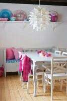 50s artichoke designer lamp above dining set and bench in white, Scandinavian kitchen-dining room with pink accents