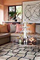 Living room in metallic shades with stylised metal Christmas tree on coffee table