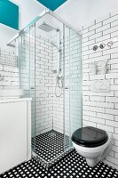 Contemporary bathroom with shower and toilet and black and white colour scheme