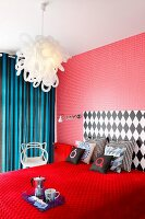 Bedroom with red, patterned wallpaper and breakfast bed on red bedspread