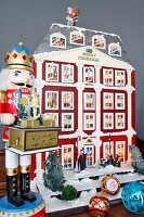 Traditional Hussar nutcracker and house-shaped Advent calender