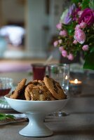 Chocolate-chip cookies in white china dish on set table