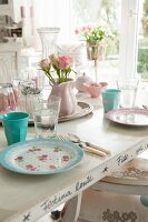 Table set with romantic pastel crockery