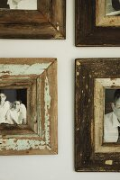 Detail of gallery of photographs with vintage wooden frames