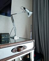 Anglepoise desk lamp on table made from mirrored suitcase