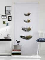 Guinea fowl feathers printed on roll of paper as wall decoration