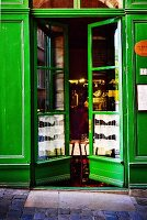 Green-painted front door of restaurant
