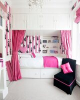 Girl's bedroom in white, pink and black with cubby bed