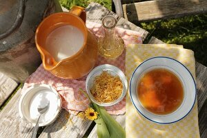 Ingredients for hand soak or scrub; honey, marigolds and milk