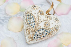 White heart pendant with gilt and rhinestone decorations