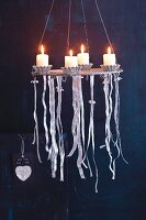 A burning advent wreath made from a round grill rack with decorative ribbons
