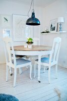 White furniture in Swedish-style dining room