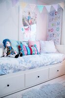 Child's bedroom in pastel shades with bunting above bed