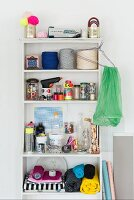 A shelf of craft materials